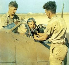 Flight Lieutenant Pentland of 417 Squadron RAF, is being strapped into his Spitfire at a base in North Africa - World War 2