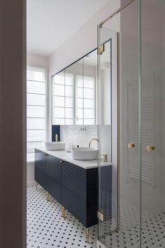 polka dot floor tile design, bass legs on the cabinetry