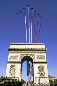 """French Air Force Dassault/Dornier Alpha Jets of the """"Patrouille de France"""" aerobatic team trailing the colors of the French tricolor national flag over Arc de Triomphe and Champs-Élysées avenue in Paris at the 2011 Bastille Day Parade. Paris Travel, France Travel, Bastille Day, Paris Bastille, Triomphe, I Love Paris, Paris Ville, Paris City, Champs Elysees"""