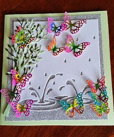 Memory Box Splashing Puddles Die with Butterflies cut from Memory Box Kensington Branch & MB Small Alder Tree die. I cut the butterflies in white card and coloured them with Crayola markers