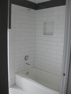 I want to tile around the tub to look like this. 4x12 subway tile