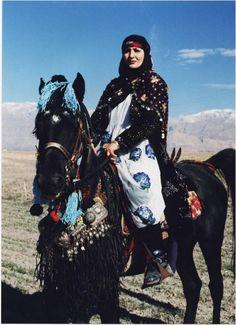 Kurdish woman on horse