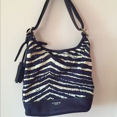 AUTHENTIC Coach Legacy Zebra Print Duffle Bag A fun and unique bag that can be worn as either a shoulder bag or crossbody bag! Used, but in pretty good condition with some wear on the bottom corners & zipper, and a marking on the back of bag.  1 compartment with 2 pockets on the front and 1 zipper pocket on the back. 1 external pocket on the back. Zipper closure. Coach Bags