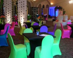 Bright neon colored spandex chair covers in the Ballroom set-up for a Sweet 16 Birthday Party at Sonterra Country Club.