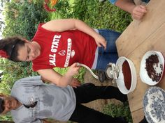 This is a picture of me grinding the cacao bean. We visited a farm where we were able to harvest a cacao pod, roast the cacao, crack the shell off, and grind the cacao. We used the cacao we made for hot cocoa and it was wonderful!