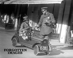 Cop Writing Ticket To Pedal Car Driver 1920s