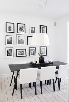 Love the photo display...could be a way to tie in more white to the dining room?