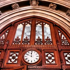A clock above a large old door to the entrance of the Houses of Parliament in London.. #clock #door #entrance #london #westminster #thames #river #capital #architecture #historic #history #parliament #housesofparliament #government #royalty #landmark #touristattraction #tourist #england #travel