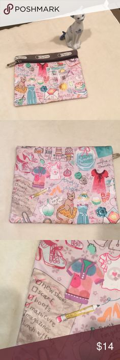 LeSportsac Makeup Pouch Cat, Femme, martini This a super cute pouch. 💫IT IS IN LOVED CONDITION💫 I did use this. It does have Makeup stains inside and a few spots on the outside. Notice photos of some😀. Have any questions please feel free to ask. ONLY REASONABLE OFFERS EXCEPTED 🚫 NO TRADES🚫 My home is smoke free I do have pets. Have any questions please feel free to ask😊. Thanks for the taking a look at my closet😄 Lesportsac Bags Cosmetic Bags & Cases