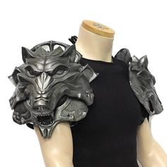 Polyurethane (PU) shoulder armour. Pictured in Dark Steel finish. Pair of beautiful Wolf Head pauldrons designed by the very talented Jay Cooling from Dragon Armoury. Each pauldron comes in two separate parts so that the mouth articulates. Complete with black leather straps and