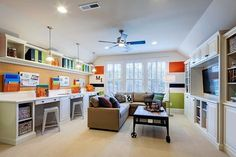 If only our bonus room was this wide. I like the multi-function of the space that acts as a fun den, media room, office, & craft room :: M/I Homes of Raleigh: Woods at Umstead - Birmingham Model Room, Homework Room, Hangout Room, Home, Family Room Design, Media Room, Game Room Kids, Bonus Rooms, Office Playroom