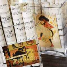 Chicago table: pics of chicago related items and sheet music. Old books. candles and pinwheels in muted shades