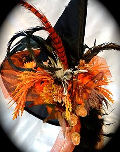 I adore this hat   http://www.etsy.com/listing/157964445/the-fire-maiden-witch-hat-ooak