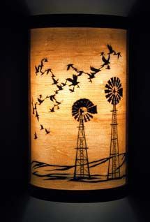 Lamp/ Sconce A collaboration with Nikki McClure and Jay T Scott  This is simply beautiful!