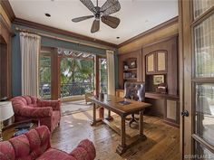 Traditional home office - French doors and balcony on the water.  Aqualane Shores in Naples, Florida