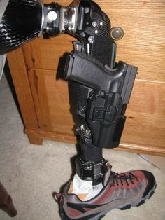 Leg Holster Rig, cyberpunk, cyber, implant, prosthetic leg, gun, weapon, future, futuristic, cyborg, augmentation by FuturisticNews.com