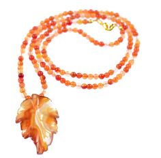 CARNELIAN LEAF NECKLACE    Carnelian and gold-plated long pendant necklace.     Get the rustic look with this long pendant necklace. Matching items available.  ...  Colour: Orange    Size: 71.5    £57.00     http://www.gemjewelleryshop.com/product-information/36/379/carnelian-leaf-necklace/See More