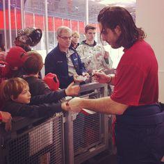 Photo by washingtoncaps - Caps forward Mathieu Perreault signs autographs for fans after practice