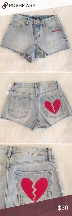 """Kendall & Kylie Linda blue mid rise denim shorts Kendall & Kylie Linda blue mid rise denim shorts in a size 22 from pacsun. The word """"heartbreak"""" is on the left pocket in the front and a heart on the right pocket in the back. These are brand new and have never been worn! PacSun Shorts Jean Shorts"""