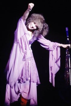 Stevie onstage  ~ ☆♥❤♥☆ ~    lovely in lavender, doing a fist pump after nailing a song she performed with the other members of Fleetwood Mac during their 'Tusk' tour, 1979