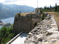 Assos - Castle View of the entrance from on top of the wall.Venetian Fortress dates from 1585 - was the seat of the Venetian provveditore until Greece Wedding, Greece Travel, Greek Islands, Athens, Venetian, Villas, Entrance, Scotland, Paradise