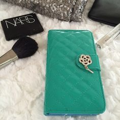 iPhone 6 case Brand new iPhone 6 PU leather case with magnetic closure. Designed to protect your phone and will allow you to easily carry it with a wrist strap. Able to hold 3-4 credit cards and there is an additional slot for cash. Accessories Phone Cases