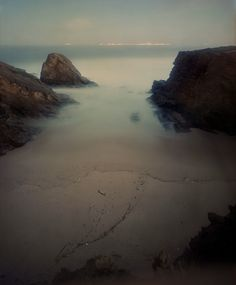 """A hauntingly beautiful photo from Christian's Chaize's """"Praia Piquinia"""" series. This long-exposure image was taken during a late-night thunderstorm."""