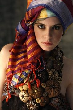 Boho style covering. Really don't care for the funky flower things though, but the headscarf is pretty-- sort of slouchy and relaxed.