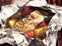 Grilled Lemon Pepper Halibut and Squash Packs: Grilling foil bundles is the secret to creating moist and flavorful fish and veggies.