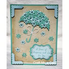 Beautiful handmade umbrella bridal shower card. Made using Cricut design space and flower hole punch. Made by Craft Me a Card.