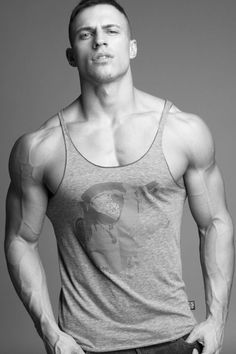 Men's fashion | Super buff dude in a tank top. Black and white shot of men's clothing. Hot men. https://www.pinterest.com/trevorellestad/all-of-the-handsome-dudes/