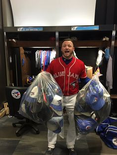 That's quite the collection of hats!  Josh Donaldson with all the hats that made their way onto the field after his hat trick - 3 homers in a game.  That's how we do it here in Canada.