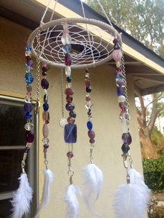 A personal favorite from my Etsy shop https://www.etsy.com/listing/175189339/dream-catcher-dreamcatcher-mobile