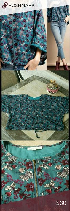 """NWOT Cropped Zip Up Top New without tags, zip up, cropped, bell sleeved floral top. Full zipper. Loose design. Brand: easel  (boutique). Size Medium. 100% Rayon. When laying flat and zippered, length: 22"""", across chest: 28"""". No damage or defects. Comes from a smoke free home. Final price unless bundled. No trades, no holds, thank you. easel Tops"""