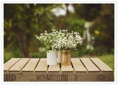 Who thought that spray-painted tin cans and inexpensive flowers could look so gorgeous for a wedding?