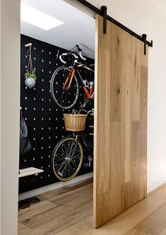 17 Amazing Bike Storage Ideas You Just Have To See Amazing space-saving cool bike storage ideas for small room and apartments. These indoor bike storage solutions are for pedal pushers who can't part with their bike. Indoor Bike Storage, Bicycle Storage, Bike Storage Room Design, Bike Storage In House, Outside Bike Storage, Home Bike Rack, Scooter Storage, Bicycle Rack, Overhead Storage