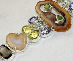 Agate Geode SliceAmethyst FacetedCitrine FacetedPeridot FacetedSmokey Quartz bracelet designed and created by Sizzling Silver. Please visit  www.sizzlingsilver.com. Product code: BR-9477