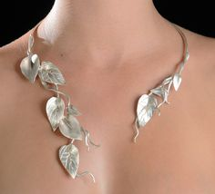 "Necklace | Nikolaev Designs.  ""Bougainvillea Leaf Wrap"".  Sterling silver"
