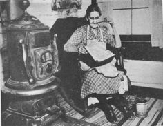 Kentucky mountain woman is here shown enjoying a book brought by a WPA pack horse librarian, 1930s in Whitley County, KY.