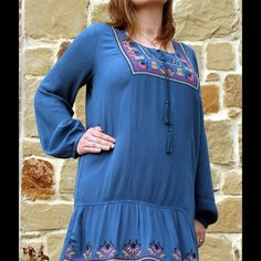 Spring Blue Boho Gauze Dress! Long sleeve summer dress with flower embroidery detailing. The sleeves have elastic so they can be easily be pulled up. 100% rayon. Limes Clothing  Dresses
