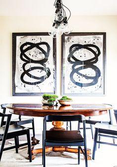 Dark wood dining space with modern art.