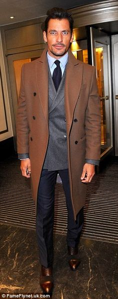 Dapper David: Bringing his signature style to the event, model David Gandy sported his tra...