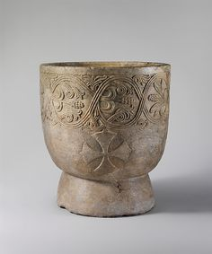 Baptismal Font Date: 1137 Geography: Made in probably Sicily, Calabria, Southern Italy Culture: South Italian Medium: Pentelic Marble Dimensions: Overall: 26 3/4 x 24 7/16 in. (68 x 62 cm) rim thickness: 1 3/4 in. (4.4 cm)