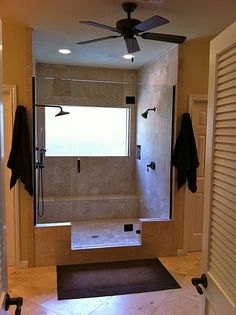 Love this bath remodel where the tub was removed for a double shower.