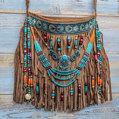 Our bohemian bags are the perfect blend of colors & textures spiced up with small gems, charms and all those goodies that make the heart flutter. Boho Hippie, Hippie Purse, Hippie Bags, Boho Bags, Hippie Style, Ethnic Jewelry, Bohemian Jewelry, Mundo Hippie, Estilo Hippie