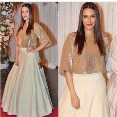 in embellished crop top & voluminous skirt from evening wear collection Indian Gowns Dresses, Pakistani Dresses, Indian Party Wear, Indian Wear, Indian Attire, Indian Outfits, Mehendi Outfits, Indian Designer Outfits, Designer Dresses