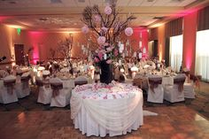 just like the center tall piece.  not a fan of chair covers.  not sure if i like the pink uplighting.