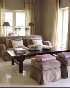 This is the perfect pic to prove why I insist so often client's pull their sofa away from the wall and place a sofa table behind it. It provides great depth and a perfect spot to place a couple of lamps and accessories. Try it! You'll love it!