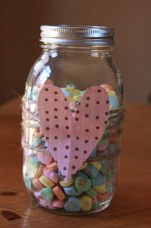 Valentines Mason Jar - we have mason jars, we are missing the twine and sweetheart candies or maybe kisses, and Jacob could practice cutting skills simple heart fold paper/material in half and cut a teardrop shape