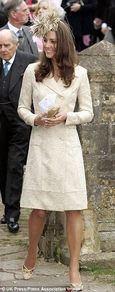 She recycles looks, including a few pre-engagement ones. Three outfits worn three times (as in the Day Birger et Mikkelsen brocade coat, pictured above on three different occasions), eight outfits worn twice.  Duchess in her Day Birger et Mikkelsen brocade coat